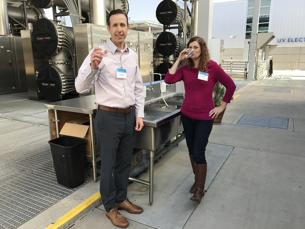 TrojanUV Market Manager Adam Festger & National Water Research Institute's Gina Melin Vartanian toast Orange County Water District's success in setting a Guinness World Record for the Most Wastewater Recycled to Drinking Water in 24 hours.